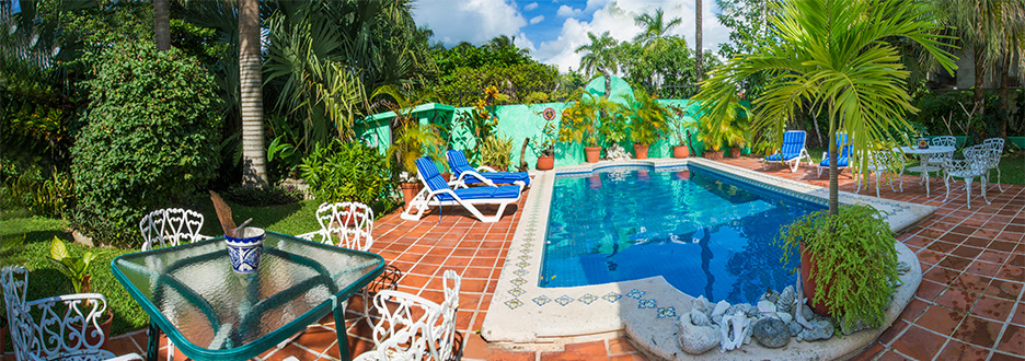 Pool and patio area at Tres Palmas Cozumel vacation rental villa
