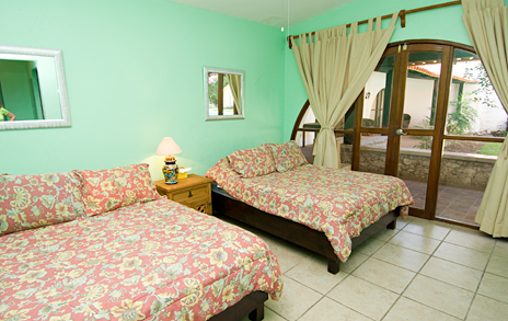 Bedroom #2 at Villa Caracol has 2 double beds