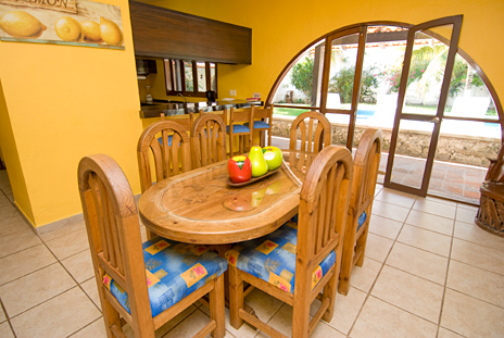 Dining room at Villa Caracol, 5 BR vacational rental property in Cozumel