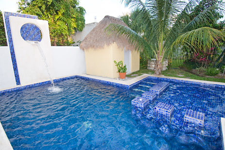 Pool area at Villa Escondida Cozumel vacation rental B & B