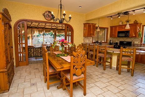 Dining area  and kitchen of Hacienda Izamal vacation villa rental in Cozumel, Mexico