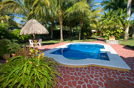 Swimming pool and garden area of Hacienda Izamal vacation villa rental