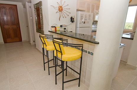 Lunch counter off kitchen of las Brisas 402 Cozumel vacation rental home