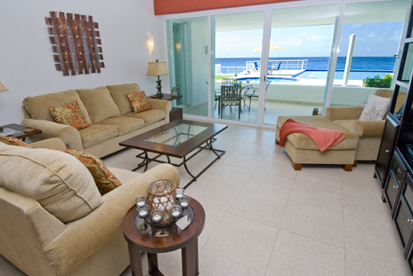 Dining room, living room and kitchen of Nah Ha 201 3 BR oceanfront vacation rental condo in Cozumel have ocean views