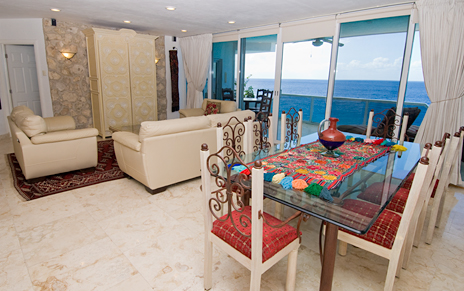 Living room and dining room of Puesta del Sol 6S Cozumel vacation rental condo