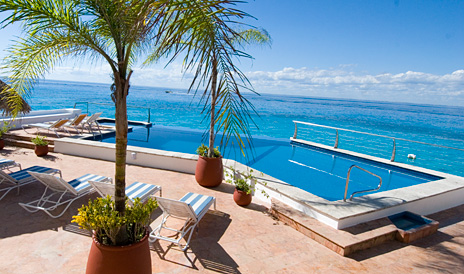Pool and sea view at Puesta del Sol Cozumel vacation rental property