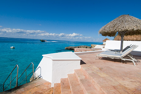 Stairs lead into the sea at Puesta del Sol Cozumel vacation rental  villas