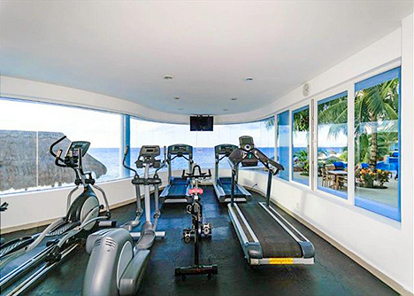 Ocean view workout room at Peninsula vacation rental condo