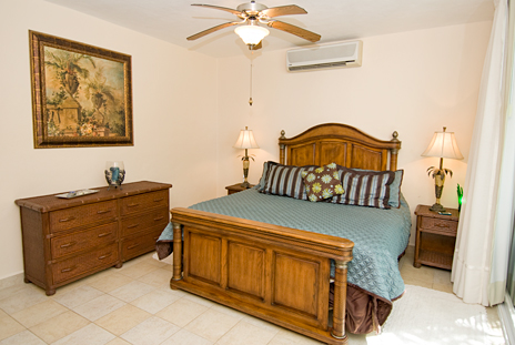 Ocean views surround you in the living room at Residencias Reef 5100 Cozumel vacation rental condo