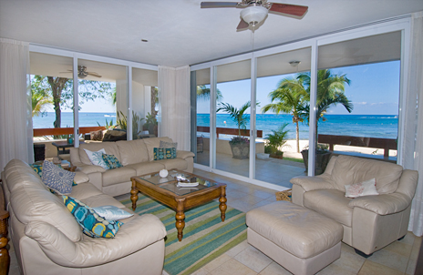 Living area with ocean views at RR 5100 at Residencias Reef Cozumel