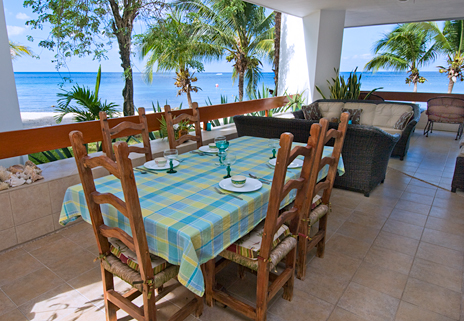 Dining area on the wrap around patio at Residencias Reef 5100 Cozumel vacation rental condo