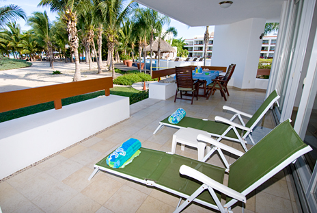 Lounge chairs on Residencias Reef 5140 patio Cozumel Mexico