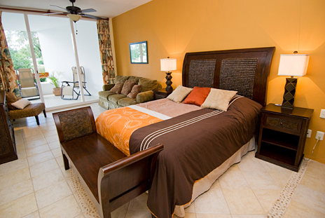 Glass doors in the bedroom open to the patio in RR 7160 at Residencias Reef vacation rental condo