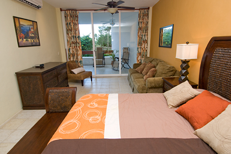 Bedroom has queen bed in RR 7160 at Residencias Reef vacation rental condo