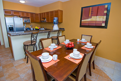 Dining  room with kitchen in the background  in RR 7160 at Residencias Reef vacation rental condo