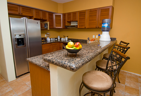 Kitchen has a lunch counter in RR 7160 at Residencias Reef vacation rental condo