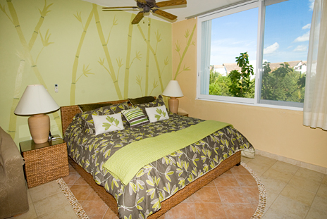 King bed in RR 8310 at Residencias Reef