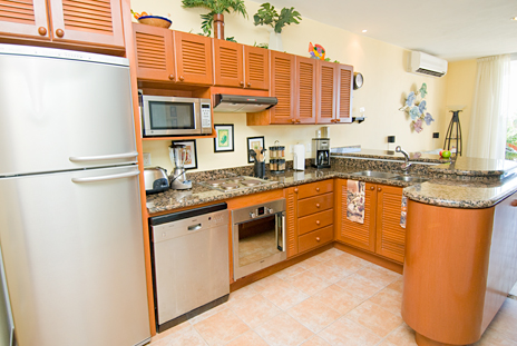 Completely equipped kitchen in RR 8310 at Residencias Reef in Cozumel