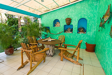 Covered patio area is great for dining outdoors at Tres Palmas Cozumel vacation rental property