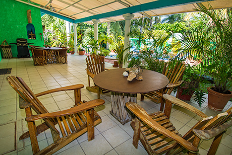 View from the pool area looking toward the large covered patio area of Tres Palmas vacation rental property in Cozumel