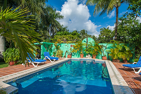Pool, patio and garden area is an outstanding feature of Tres Palmas Cozmel vacation rental villa