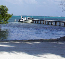 boat and pier at costa de cocos